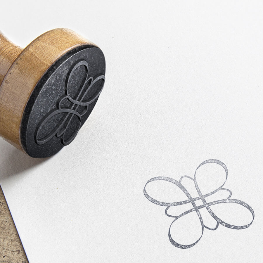 rubber stamp with logo design for Minett