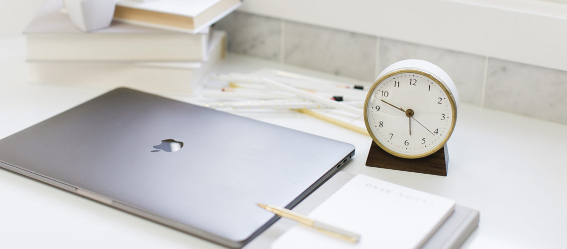 promotional image for post 5 steps to a successful social media strategy with laptop, notebook and alarm clock on a desk