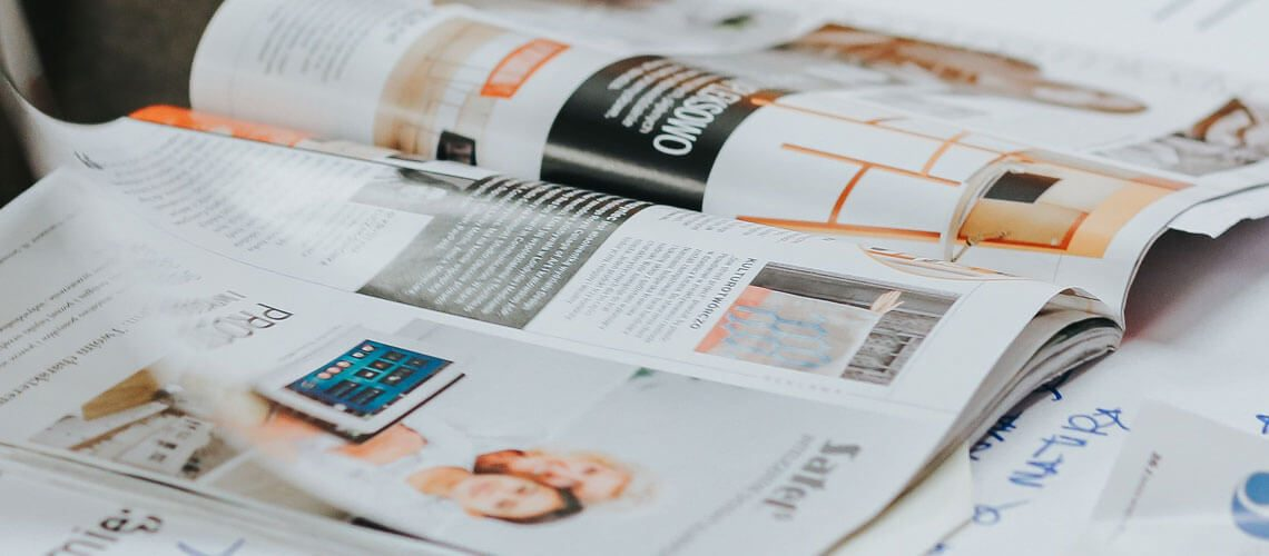 woman turning magazine page looking for brand board inspiration